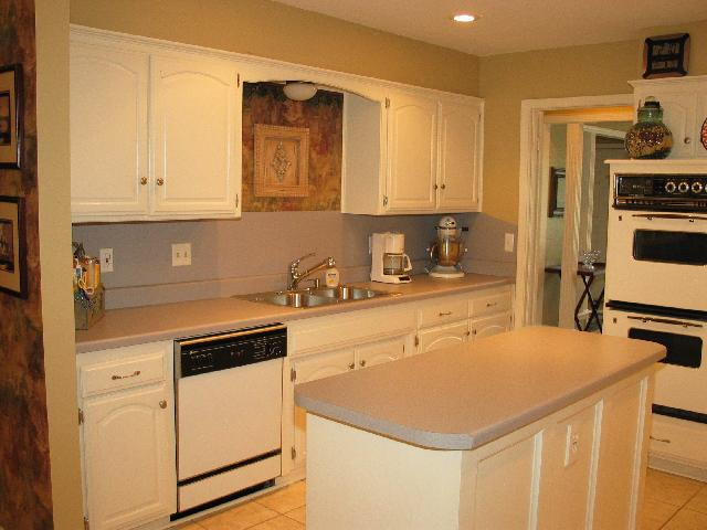 Another view of the kitchen showing the sink and dish washer.  There are LOTS of cabinets!