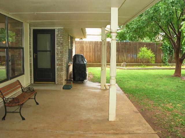 Another view of the yard showing the covered patio
